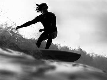 grayscale photo of man riding a surfboard - Captured in Morro Bay cruisin single stag. Morro Bay, United States