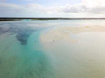 Low tide in Exuma, The Bahamas. - body of water under white clouds at daytime. Exuma, The Bahamas