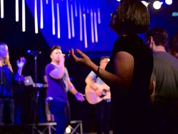 Authentic Worship - people standing near people playing instruments.
