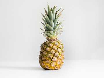 pineapple front - pineapple on white surface.