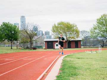 Track workout at Austin High School. - man in black shirt and black shorts running on track field during daytime. Austin High School, West