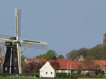 Village with mill on Zeeland in Holland - Village with mill on Zeeland in Holland