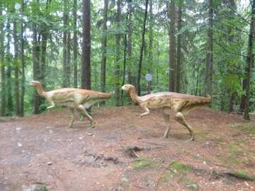 dinosaurs - Running dinosaurs by the trees