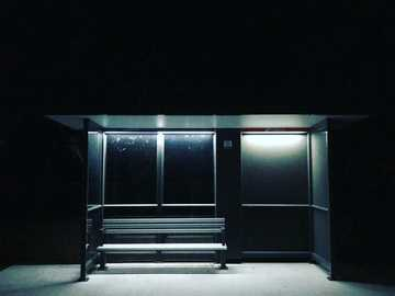 Bus stop at night - black and white wooden cabinet. 30 Gothic Parade, Currimundi, Australia