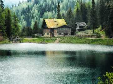 idyllic landscape - idyllic place with house on the lake
