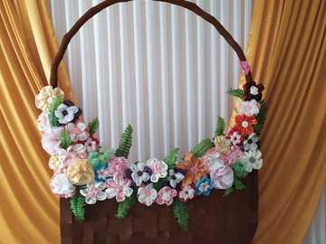 ziua mamei - in aceasta imagine este reprezentat un cos cu florii