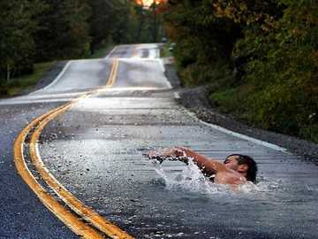 sport with a difference - Man, swimming, road, nature