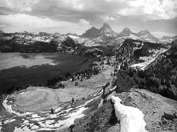 greyscale photography of mountain hill cover with snow - This pic is taken at 9K feet at the top of Grand Targhee Ski Resort and Bike park in July 2014. Alta