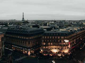 #paris #roof #parisien #eiffel #moody #dark - cars parked on parking lot near brown building during night time. Paris, France