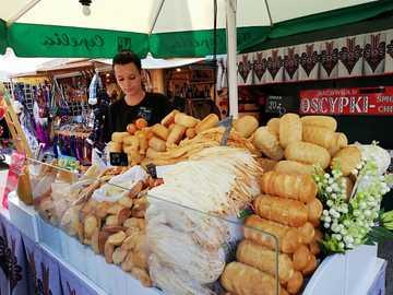 Krakow. Stall with oscypek cheese - Krakow. Stall with oscypek cheese