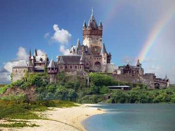 Castle by the sea - Castle by the sea with rainbow