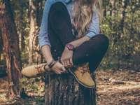 Woman watch on stump - woman sitting on tree stump.