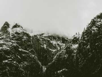 grayscale photo of mountain cover with snow - The ice-capped peaks of Yosemite!  https://heclicksshewrites.com/. Yosemite National Park, United St