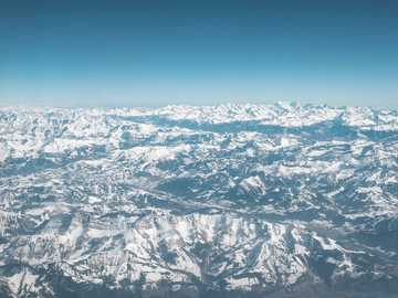 gray mountains - Snowy mountains from above. Swiss Alps, Switzerland
