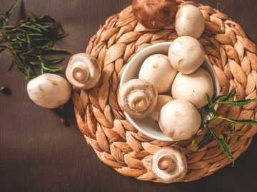 Mushroom - white garlic on brown woven basket.