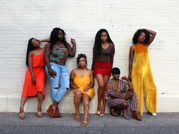 Reflecting Queens - six women leaning on white wall. Uptown, Minneapolis, United States