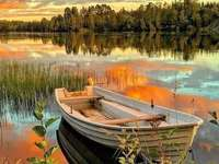 hajóval a tóra naplementekor