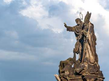 Sculpture at Charles Bridge in Prague, Czech Republic. - man riding on horse statue under white clouds during daytime. Prague, Czechia