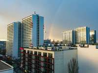 gray concrete building - Berlin after the storm with a rainbow. Berlin, Germany