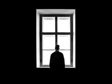 man standing in front of the window - Never give up. It is during our darkest moments that we must focus to see the light. And it will lig