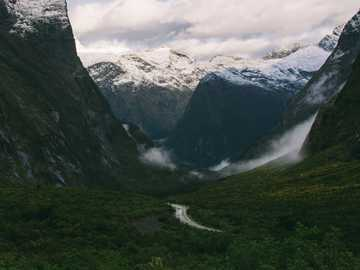 Road into the valleys - mountain covered with snow during daytime. Homer Tunnel, Fiordland National Park, New Zealand