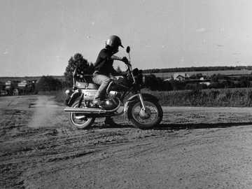 motorcycle - grayscale photo of man riding motorcycle.