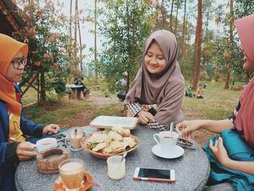 Eid Al-Fitr - woman sitting in front of table. Temanggung, Indonesia