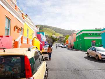 Sunrise Pop Of Color - cars parked beside road near houses during daytime. Bo-Kaap, Schotsche Kloof, Cape Town, South Afric