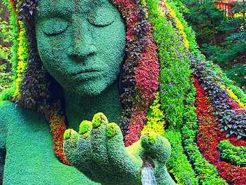 figure with flowers in the park - m .......................