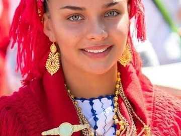 a girl from Portugal in traditional costume - a girl from Portugal in traditional costume