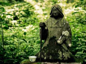 Hidden Statue - woman in coat statuette. Japan
