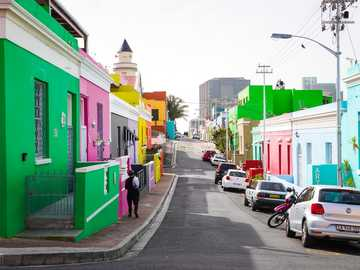 Color Run - cars parked beside green and white concrete building during daytime. Bo-Kaap, Schotsche Kloof, Cape