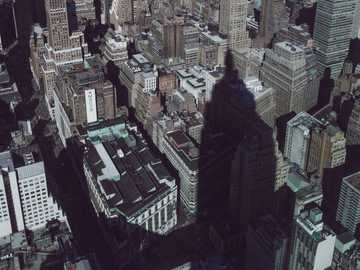 Shadow of the Giant - shadow of Empire State building on neighbor buildings. Empire State Building, New York City, USA
