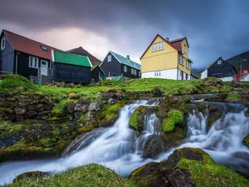 Houses and waterfall in the Faroe Islands - Houses and waterfall in the Faroe Islands