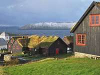 Houses on the coast of the Faroe Islands Kirkjubour - Houses on the coast of the Faroe Islands Kirkjubour