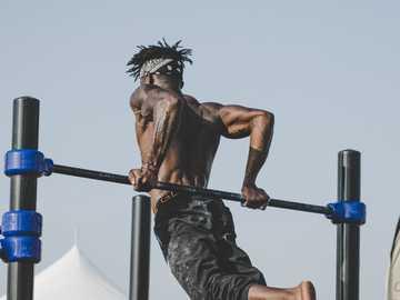 Dubai workout - man doing gymnastic. Dubai, United Arab Emirates