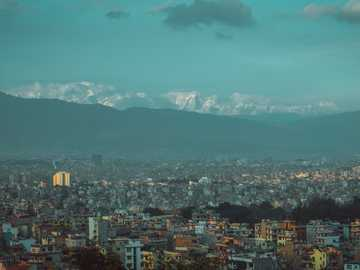 aerial view of city buildings during daytime - Landscape, crowded city hills and mountain ranges. Kathmandu