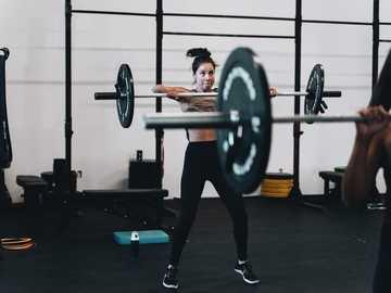 woman in black leggings and black tank top doing exercise - PORTRAITS INSTAGRAM - @LGNWVRPRTRTS  EDITORIAL INSTAGRAM - @LGNWVRPHTO  PERSONAL INSTAGRAM - @LGNWVR