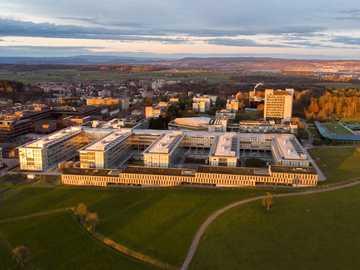 aerial view of city during daytime - Aerial shot of ETH Zurich University at sunset. ETH Hönggerberg, Zürich, Schweiz