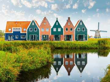 Houses and windmill in the Netherlands - Houses and windmill in the Netherlands
