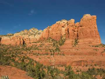 Tea Cup rock - brown rock formation under blue sky during daytime. Sedona, AZ, USA
