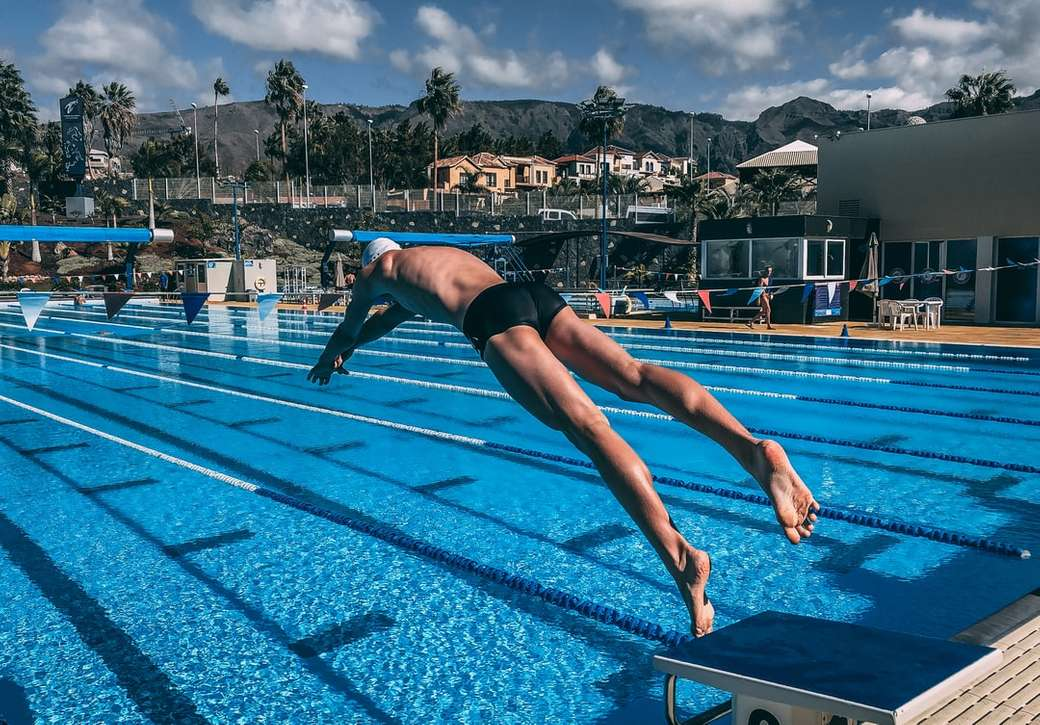 man diving in pool during daytime - Time in trainingcamp, coached by Allwetterkind. Deutschland (10×7)