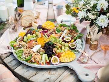 sliced fruits on white ceramic plate - food, celebration food, antipasto, a platter of food, Christmas table.