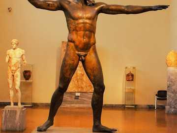 CAPE ARTEMISIO GOD SCULPTURE - NATIONAL MUSEUM OF ATHENS. GREEK SCULPTURE REPRESENTING ZEUS OR POSEIDON