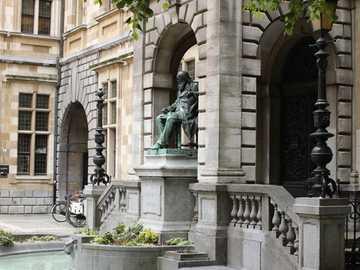 Building with statue in Antwerp - Building with statue in Antwerp