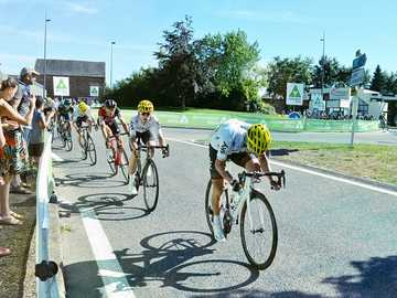 """men on road bikes racing on street - Each year, hundreds of cyclists participate in the """"TOUR DE FRANCE"""". 3500 km, 20 days of race ac"""