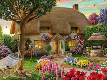 Una casa de campo con un jardín lleno de flores. - Una casa de campo con un jardín lleno de flores.