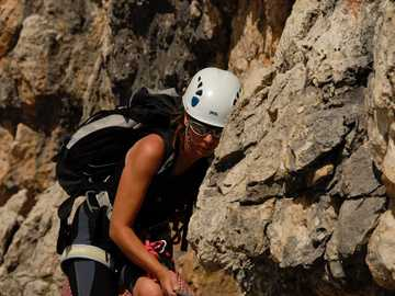 Climbing Via Ferrata Southtyrol - shallow focus photo of person wearing white safety hat and backpack. Gruppo Sella, Sella Gruppe, Dol