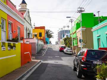 Colorful Street - cars parked on the side of the road during daytime. Bo-Kaap, Schotsche Kloof, Cape Town, South Afric