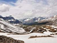 mountains covered with snow - Shoot during my 4 days hiking : Molar Pass in the Canadian rocky mountains. View from the pass. Banf